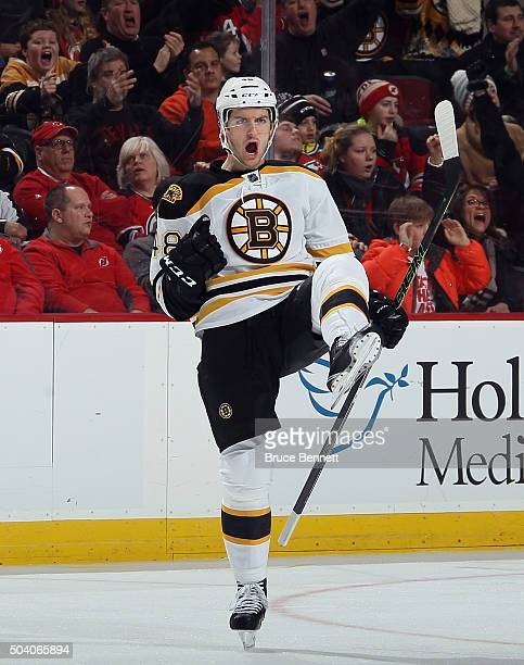 Colin Miller of the Boston Bruins celebrates his goal at 633 of the third period against the New Jersey Devils at the Prudential Center on January 8...