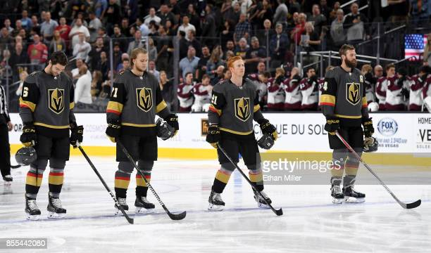 Colin Miller William Karlsson Cody Eakin and Clayton Stoner of the Vegas Golden Knights stand on the ice as the American national anthem is performed...