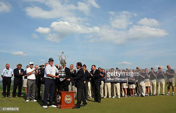 Colin Mongomerie of Scotland poses with the trophy after winning the 2015 Senior PGA Championship Presented By KitchenAid at the Pete Dye Course at...