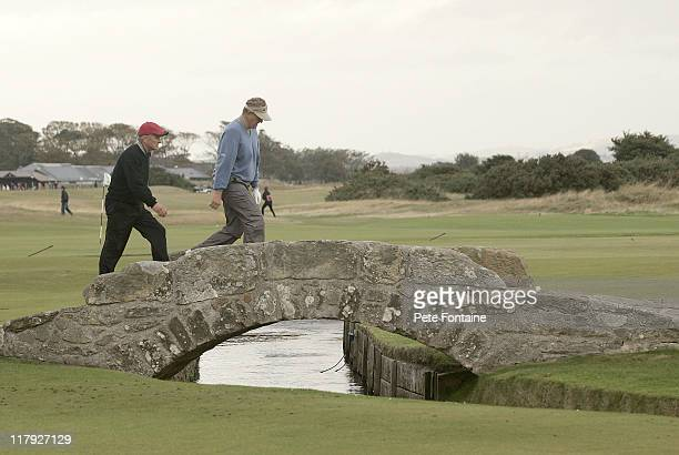 Colin Montgomerie and Michael Douglas cross the Swilken bridge on the 18th hole during the second round of the 2005 Dunhill Links Championship at the...