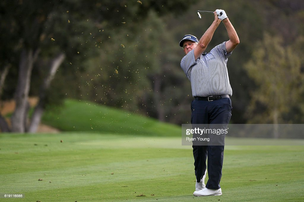 Colin Montgomerie hits an approach shot on the 18th hole during the second round for the PGA TOUR Champions PowerShares QQQ Championship at Sherwood Country Club on October 29, 2016 in Thousand Oaks, California.