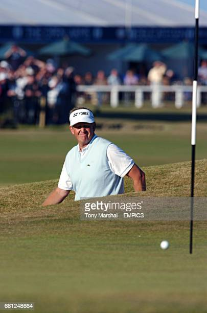 Colin Montgomerie looks happy as he looks and sees his bunker shot finish near the flag