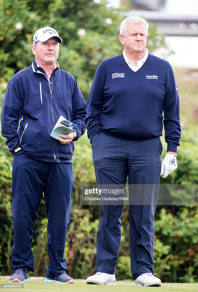 <a gi-track='captionPersonalityLinkClicked' href=/galleries/search?phrase=Colin+Montgomerie&family=editorial&specificpeople=157549 ng-click='$event.stopPropagation()'>Colin Montgomerie</a> of Scotland (R) and his caddy Alastair McLean wait on the 1st tee at the Open Championship Qualifying - Gailes on June 28, 2016 in Irvine Ayrshire Scotland.