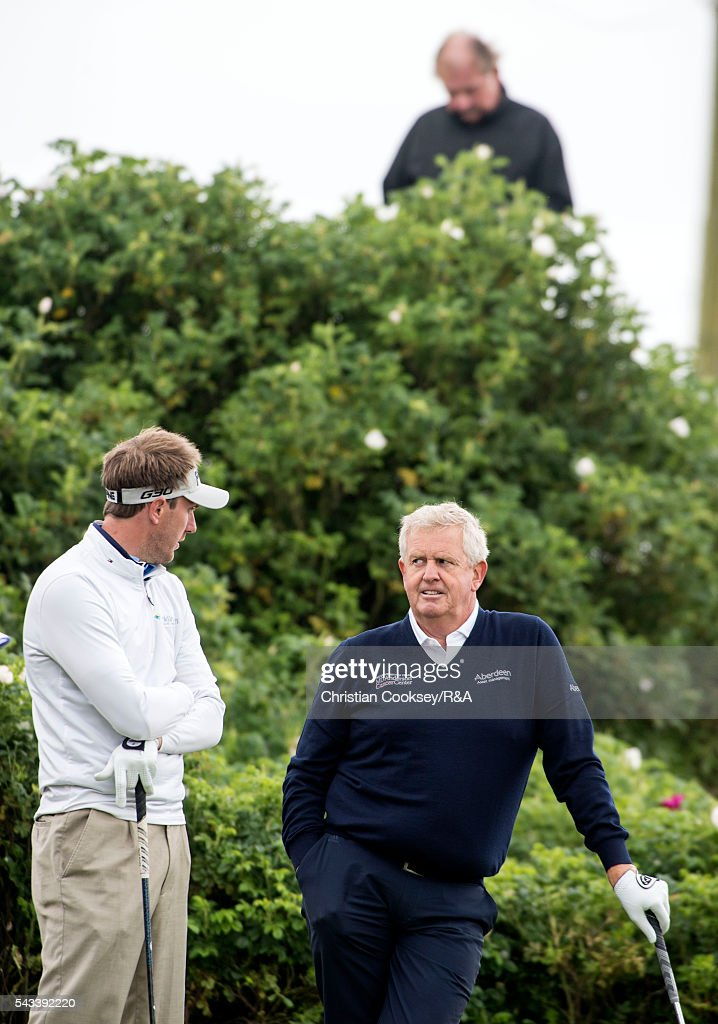 <a gi-track='captionPersonalityLinkClicked' href=/galleries/search?phrase=Colin+Montgomerie&family=editorial&specificpeople=157549 ng-click='$event.stopPropagation()'>Colin Montgomerie</a> of Scotland (R) chats with Sam Robinson of England on the 1st tee at the Open Championship Qualifying - Gailes on June 28, 2016 in Irvine Ayrshire Scotland.