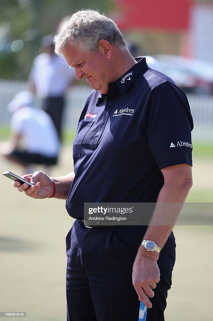 Colin Montgomerie of Scotland checks his mobile phone during the Pro Am prior to the start of The Abu Dhabi HSBC Golf Championship at Abu Dhabi Golf Club on January 16, 2013 in Abu Dhabi, United Arab Emirates.