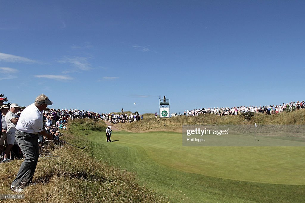 <a gi-track='captionPersonalityLinkClicked' href=/galleries/search?phrase=Colin+Montgomerie&family=editorial&specificpeople=157549 ng-click='$event.stopPropagation()'>Colin Montgomerie</a> of Scotland chips from rough onto a green during the second round of The Senior Open Championship played at Royal Birkdale Golf Club on July 26, 2013 in Southport, United Kingdom.