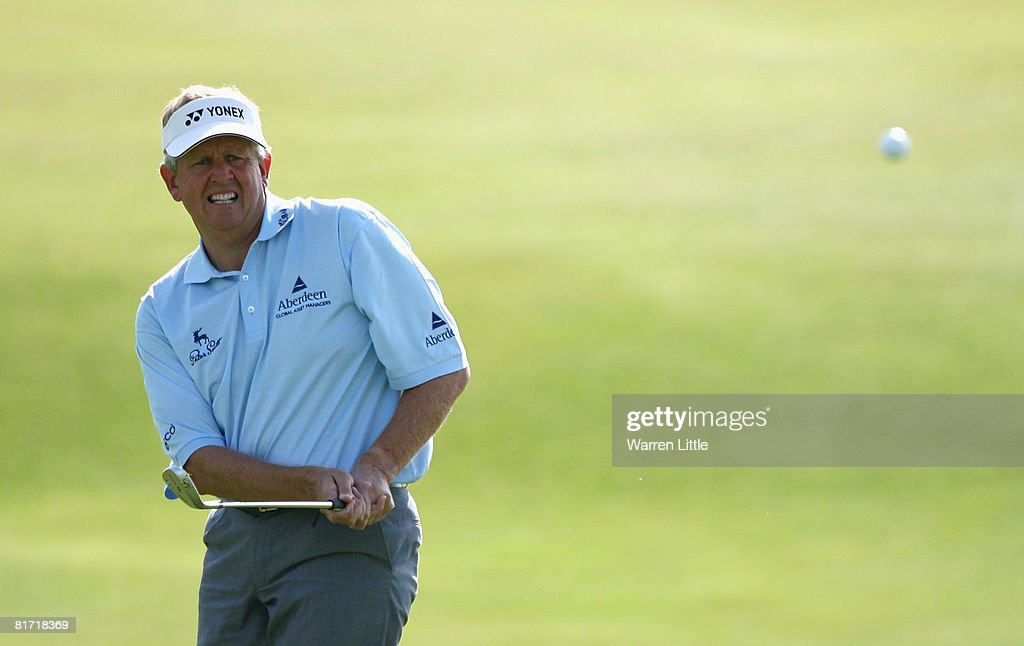 Colin Montgomerie of Scotland chips onto the 14th green during the first round of the Open de France ALSTOM at the Le Golf National Golf Club on June...