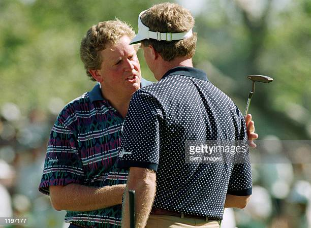 Colin Montgomerie of Scotland congratulates Steve Elkington of Australia on winning the USPGA Championship at the Riviera Country Club in Los Angeles...