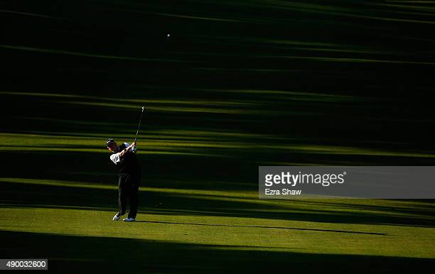 Colin Montgomerie of Scotland hits his approach shot on the 10th hole during round one of the Nature Valley First Tee Open at the Poppy Hills Golf...