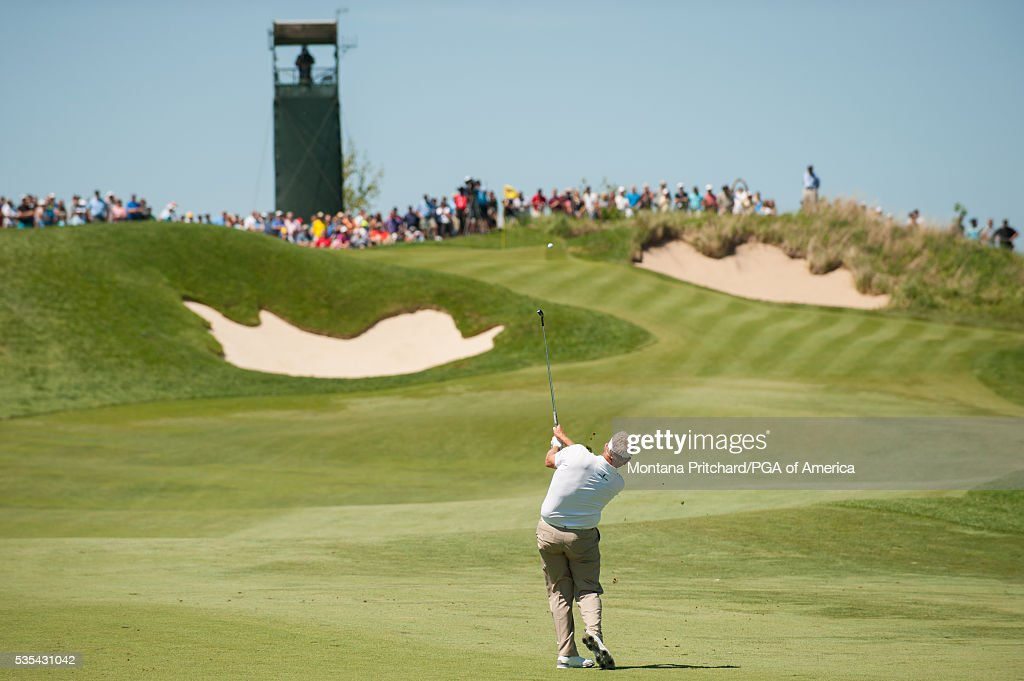 <a gi-track='captionPersonalityLinkClicked' href=/galleries/search?phrase=Colin+Montgomerie&family=editorial&specificpeople=157549 ng-click='$event.stopPropagation()'>Colin Montgomerie</a> of Scotland hits his shot on the seventh hole during the final round for the 77th Senior PGA Championship presented by KitchenAid held at Harbor Shores Golf Club on May 29, 2016 in Benton Harbor, Michigan.