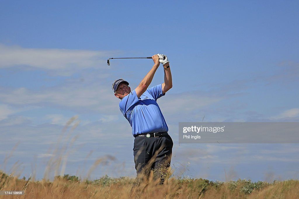 <a gi-track='captionPersonalityLinkClicked' href=/galleries/search?phrase=Colin+Montgomerie&family=editorial&specificpeople=157549 ng-click='$event.stopPropagation()'>Colin Montgomerie</a> of Scotland in action during the first round of The Senior Open Championship played at Royal Birkdale Golf Club on July 25, 2013 in Southport, United Kingdom.