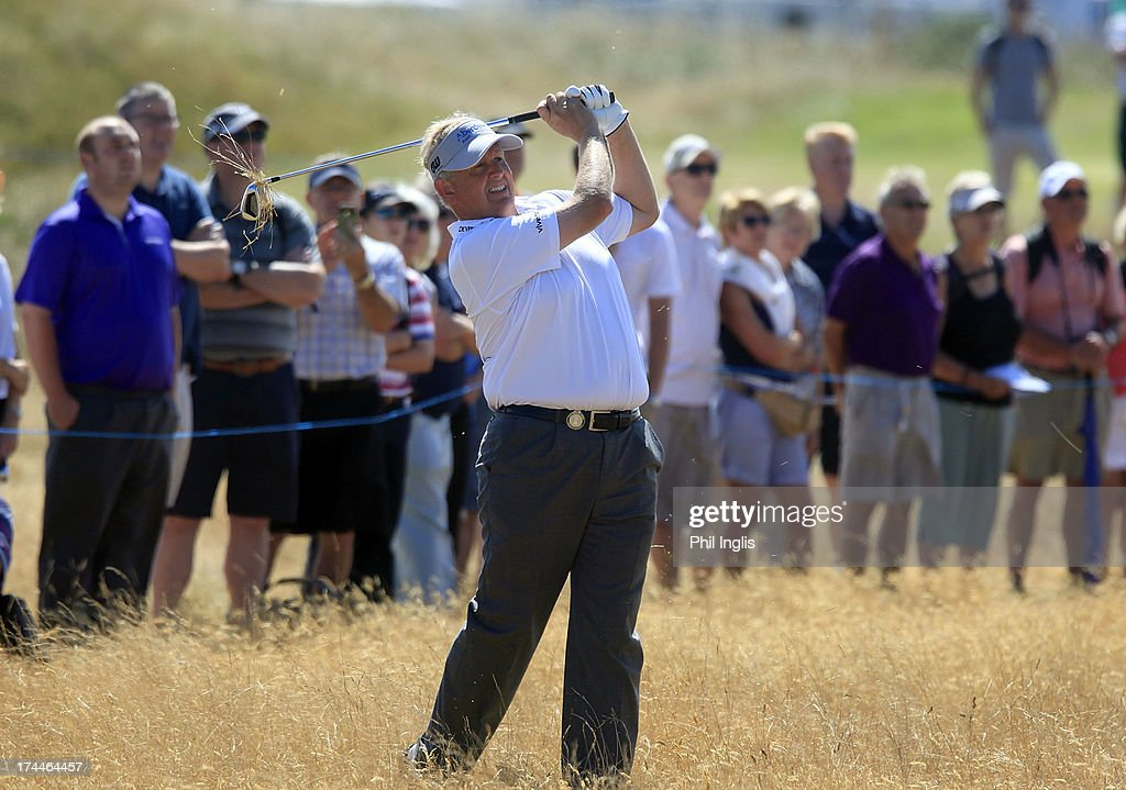 <a gi-track='captionPersonalityLinkClicked' href=/galleries/search?phrase=Colin+Montgomerie&family=editorial&specificpeople=157549 ng-click='$event.stopPropagation()'>Colin Montgomerie</a> of Scotland in action during the second round of The Senior Open Championship played at Royal Birkdale Golf Club on July 26, 2013 in Southport, United Kingdom.