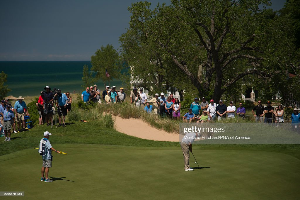 <a gi-track='captionPersonalityLinkClicked' href=/galleries/search?phrase=Colin+Montgomerie&family=editorial&specificpeople=157549 ng-click='$event.stopPropagation()'>Colin Montgomerie</a> of Scotland makes his putt on the seventh hole during the final round for the 77th Senior PGA Championship presented by KitchenAid held at Harbor Shores Golf Club on May 29, 2016 in Benton Harbor, Michigan.