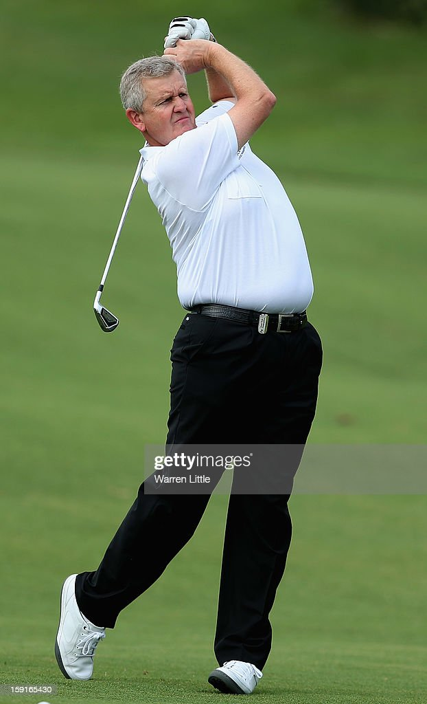 <a gi-track='captionPersonalityLinkClicked' href=/galleries/search?phrase=Colin+Montgomerie&family=editorial&specificpeople=157549 ng-click='$event.stopPropagation()'>Colin Montgomerie</a> of Scotland plays his second shot into the first green during the Pro-Am for the Volvo Golf Champions at Durban Country Club on January 9, 2013 in Durban, South Africa.