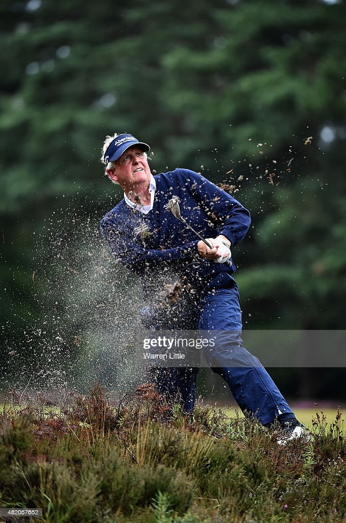 Colin Montgomerie of Scotland plays his second shot on the 12th hole from the top of a fairway bunker during the final round of The Senior Open...