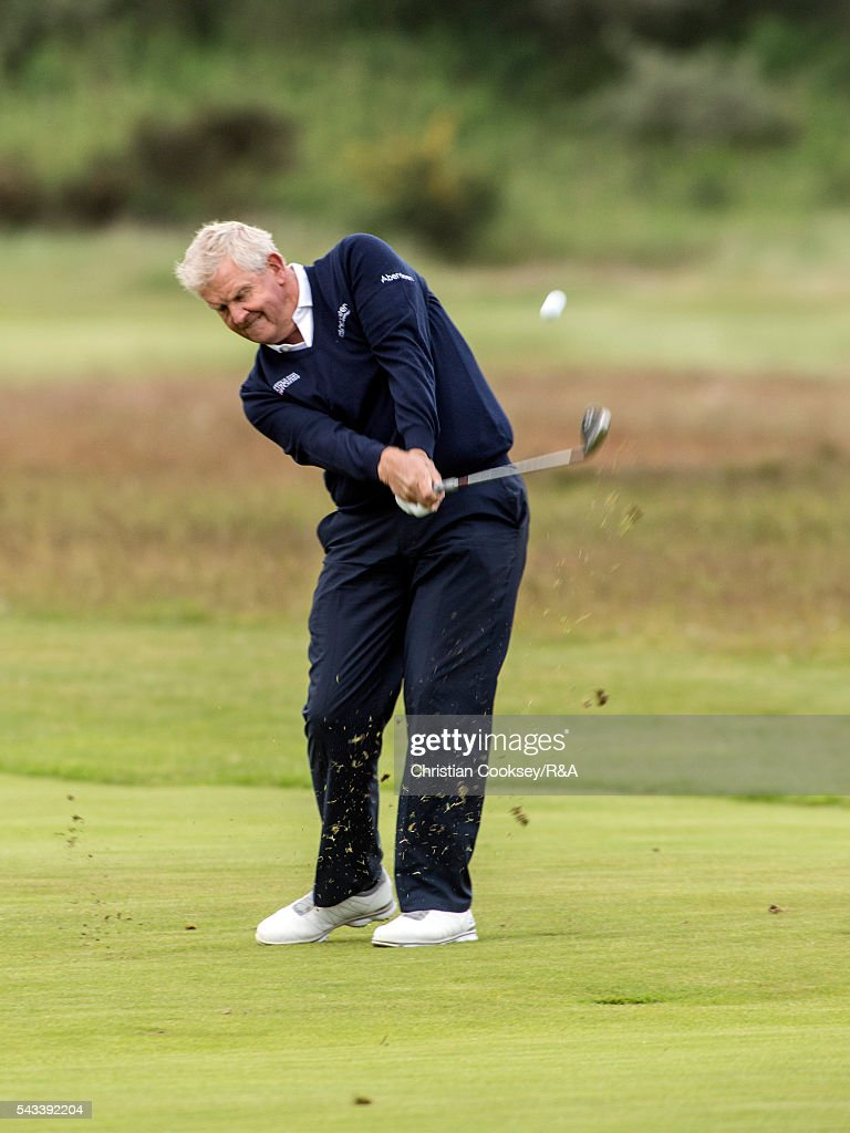 <a gi-track='captionPersonalityLinkClicked' href=/galleries/search?phrase=Colin+Montgomerie&family=editorial&specificpeople=157549 ng-click='$event.stopPropagation()'>Colin Montgomerie</a> of Scotland plays his second shot to the 1st green at the Open Championship Qualifying - Gailes on June 28, 2016 in Irvine Ayrshire Scotland.