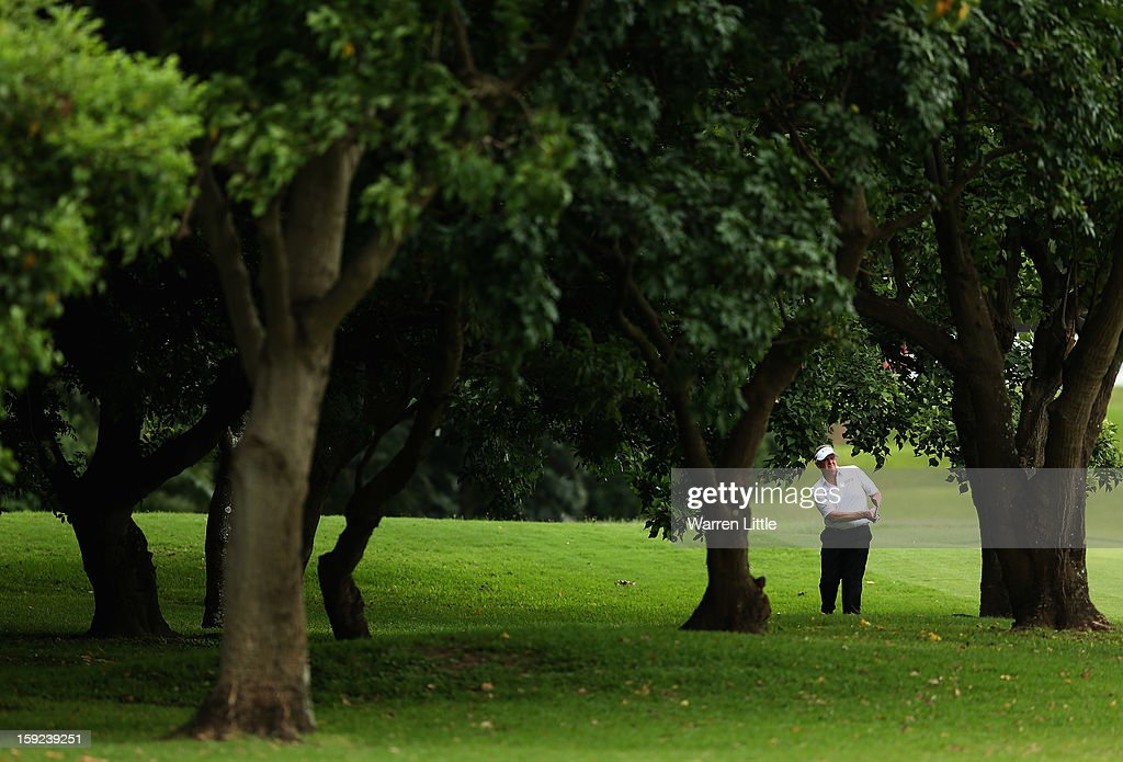<a gi-track='captionPersonalityLinkClicked' href=/galleries/search?phrase=Colin+Montgomerie&family=editorial&specificpeople=157549 ng-click='$event.stopPropagation()'>Colin Montgomerie</a> of Scotland plays out of the trees on the sixth hole during the first round of the Volvo Golf Champions at Durban Country Club on January 10, 2013 in Durban, South Africa.