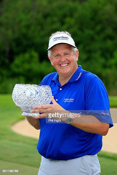 Colin Montgomerie of Scotland poses with the John Jacobs Trophy for winning the Order of Merit 2015 after the final round of the MCB Tour...