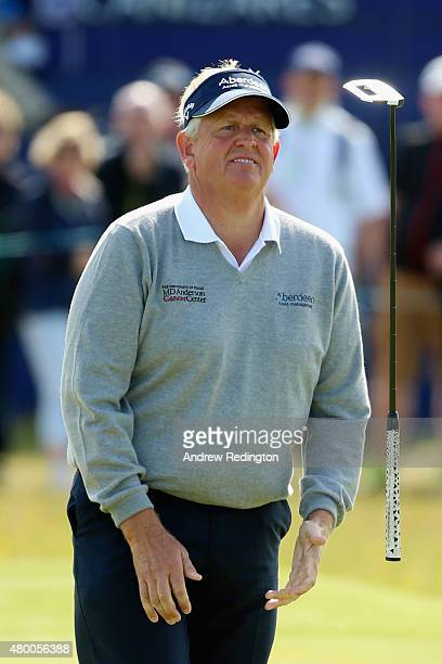 Colin Montgomerie of Scotland reacts to a missed putt on the 16th green by tossing his putter in the air during the first round of the Aberdeen Asset...