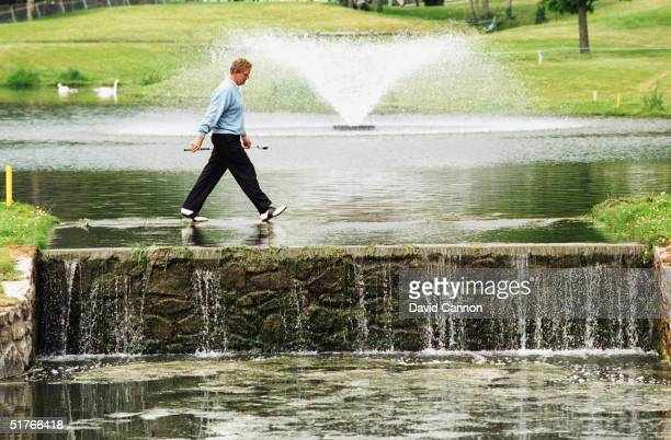 Colin Montgomerie of Scotland seems to walk on water during the final round of the Murphy's Irish Open held at the Druids Glen Golf Club on July 7...