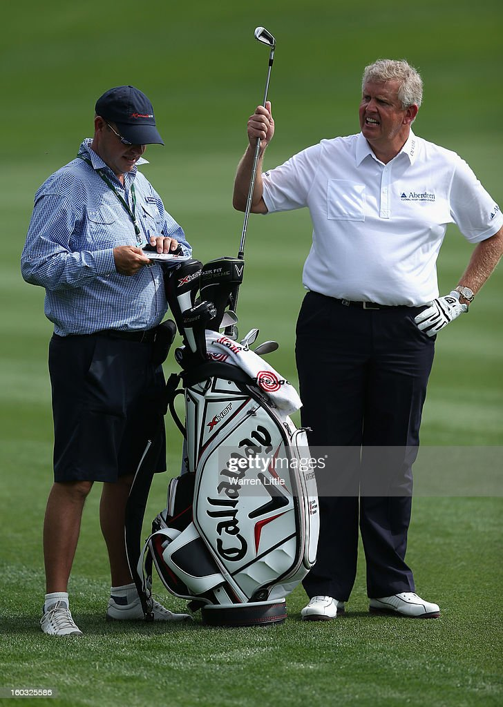 Colin Montgomerie of Scotland selects a club during a practice round ahead of the Omega Dubai Desert Classic on January 29, 2013 in Dubai, United Arab Emirates.