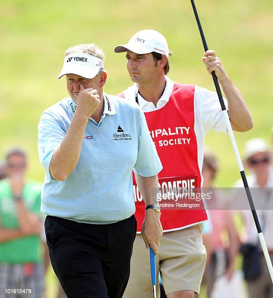 Colin Montgomerie of Scotland stands with his caddie Jason Hempelman on the first hole during the second round of the Celtic Manor Wales Open on The...