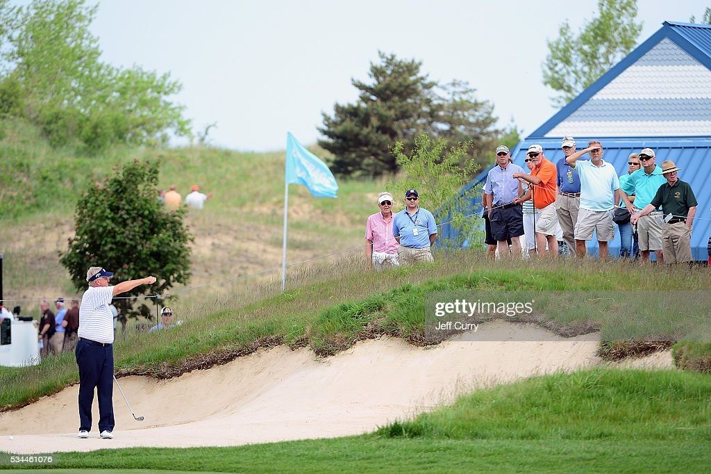 <a gi-track='captionPersonalityLinkClicked' href=/galleries/search?phrase=Colin+Montgomerie&family=editorial&specificpeople=157549 ng-click='$event.stopPropagation()'>Colin Montgomerie</a> of Scotland talks with fans as he prepares to hit from the bunker on the ninth hole during the first round 2016 Senior PGA Championship presented by KitchenAid at the Golf Club at Harbor Shores on May 26, 2016 in Benton Harbor, Michigan.