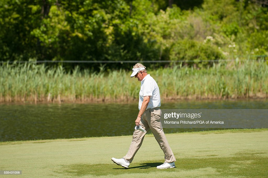 <a gi-track='captionPersonalityLinkClicked' href=/galleries/search?phrase=Colin+Montgomerie&family=editorial&specificpeople=157549 ng-click='$event.stopPropagation()'>Colin Montgomerie</a> of Scotland walks on the seventh hole during the final round for the 77th Senior PGA Championship presented by KitchenAid held at Harbor Shores Golf Club on May 29, 2016 in Benton Harbor, Michigan.