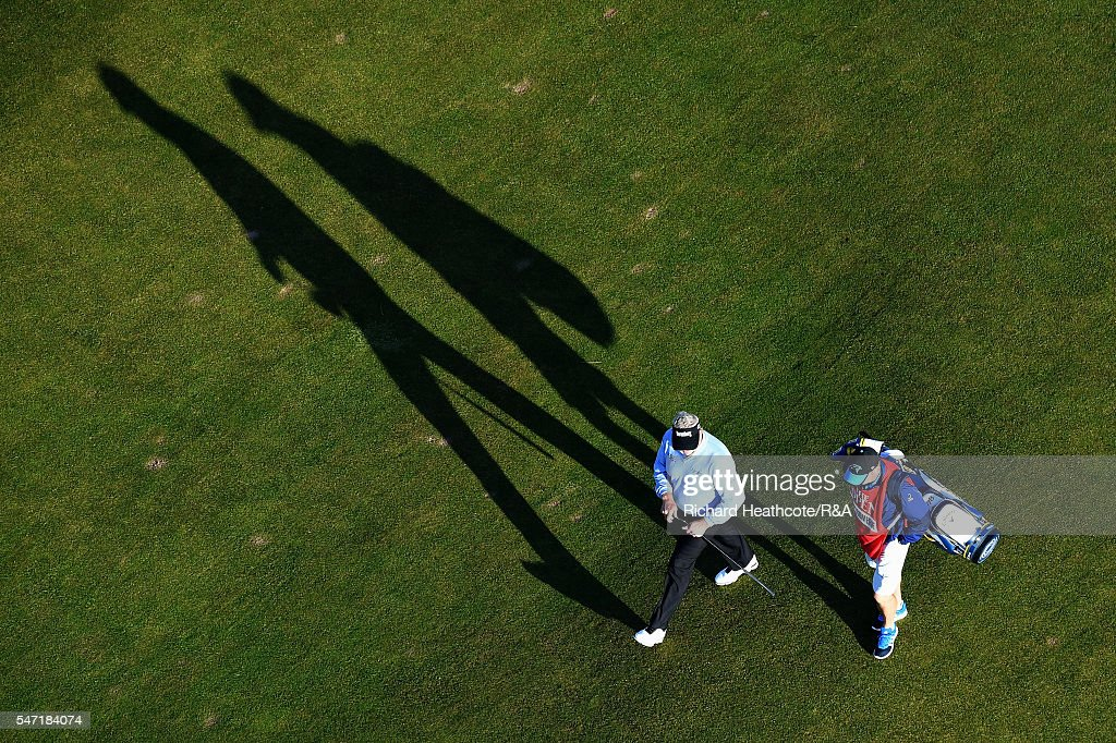 Colin Montgomerie of Scotland walks up the 2nd hole with caddie Alistair McLean during the first round on day one of the 145th Open Championship at...