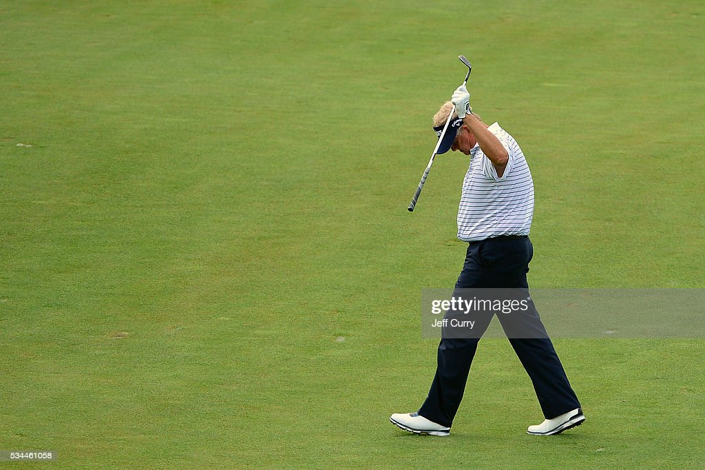 <a gi-track='captionPersonalityLinkClicked' href=/galleries/search?phrase=Colin+Montgomerie&family=editorial&specificpeople=157549 ng-click='$event.stopPropagation()'>Colin Montgomerie</a> of Scotland waves to fans after hitting from the seventh fairway during the first round 2016 Senior PGA Championship presented by KitchenAid at the Golf Club at Harbor Shores on May 26, 2016 in Benton Harbor, Michigan.