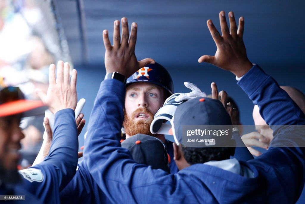 Colin Moran #19 of the Houston Astros is congratulated after hitting a home run to tie the game against the Boston Red Sox in the eighth inning during a spring training game at The Ballpark of the Palm Beaches on March 6, 2017 in West Palm Beach, Florida. The Astros and Red Sox played to a 5-5 tie.