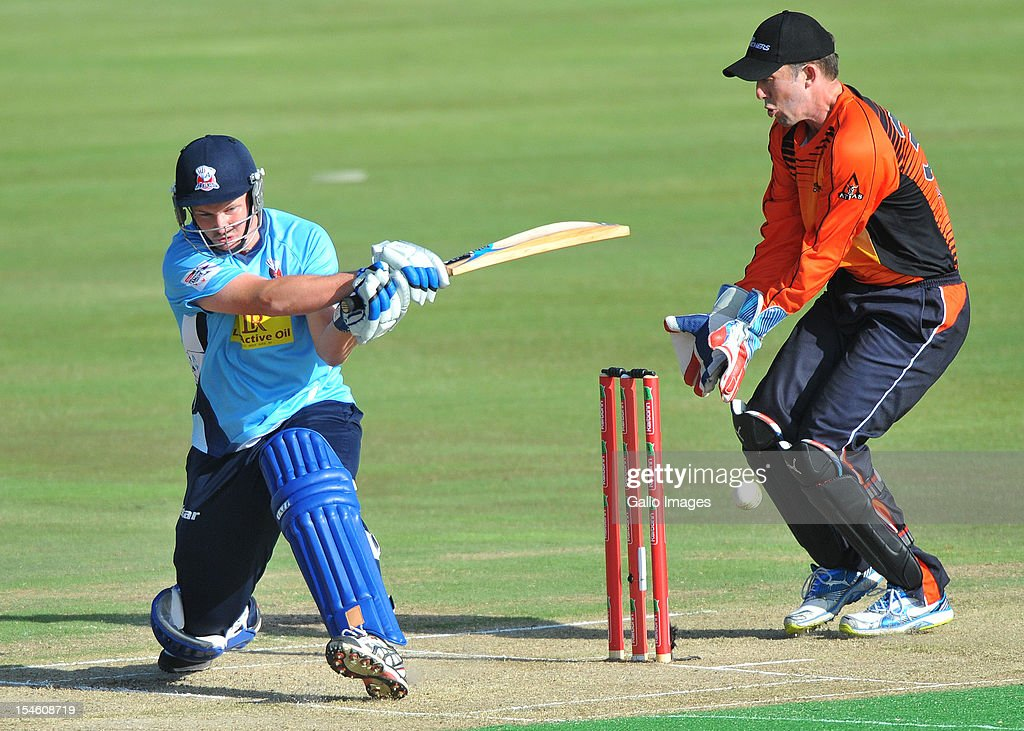 Colin Munro (L) of Aces sweeps a delivery during the Karbonn Smart CLT20 match between Auckland Aces and Perth Scorchers at SuperSport Park on October 23, 2012 in Pretoria, South Africa.