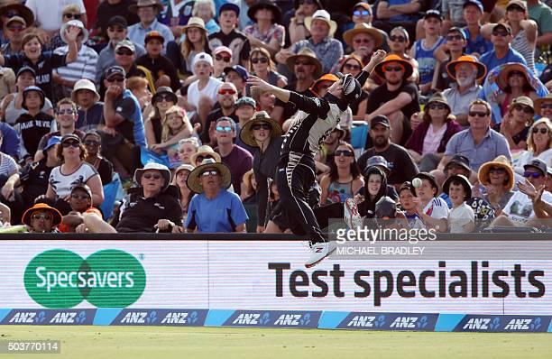 Colin Munro of New Zealand attempts to take a catch on the boundary during the first Twenty20 cricket match between New Zealand and Sri Lanka at the...