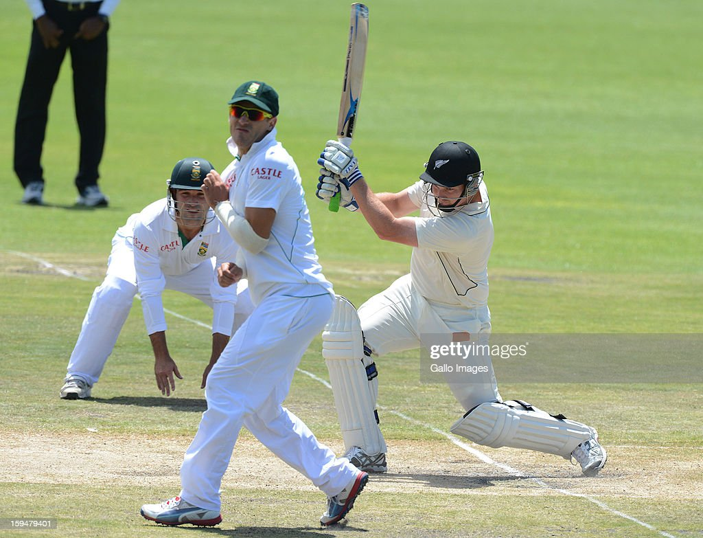 Colin Munro of New Zealand drives the ball to the boundary during day 4 of the 2nd Test match between South Africa and New Zealand at Axxess St Georges on January 14, 2013 in Port Elizabeth, South Africa.