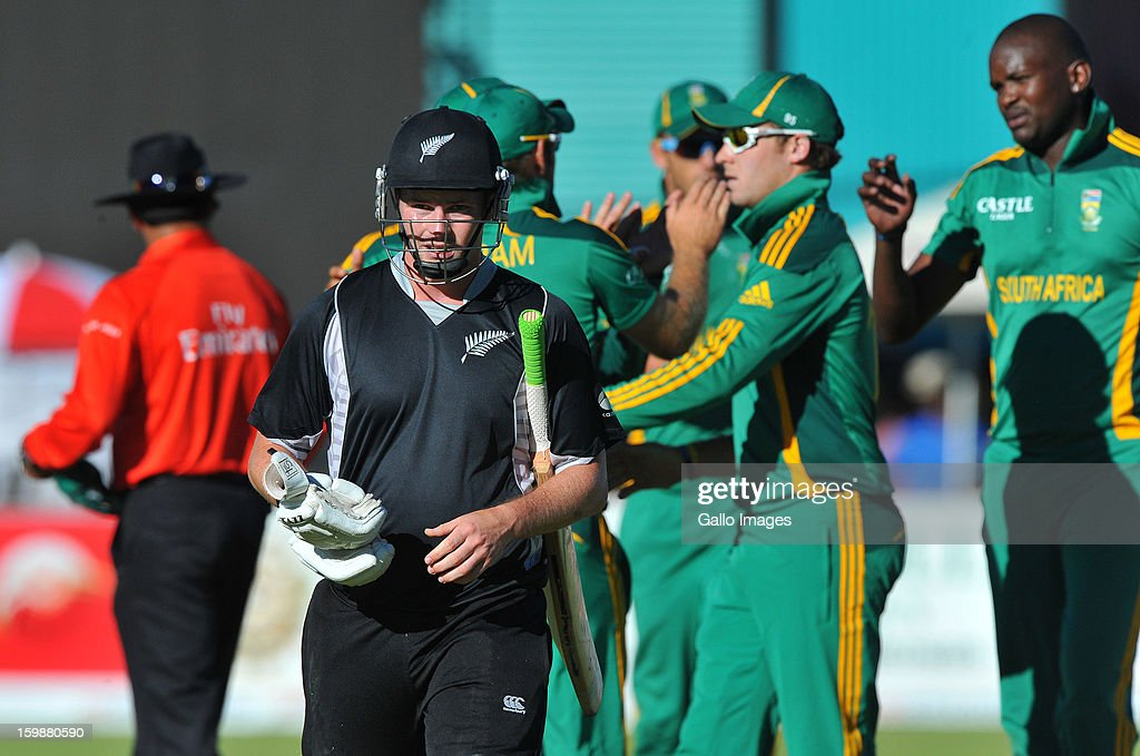 Colin Munro of New Zealand walks off for 9 runs caught by Colin Ingram during the 2nd One Day International match between South Africa and New Zealand at De Beers Diamond Oval on January 22, 2013 in Kimberley, South Africa.