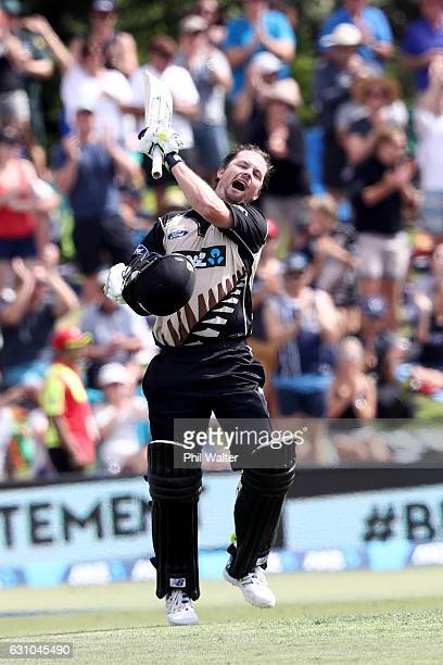 Colin Munro of the Black Caps celebrates his century during the second T20 international between New Zealand and Bangladesh at the Bay Oval on...