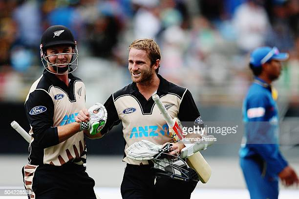 Colin Munro of the Black Caps celebrates with Kane Williamson of the Black Caps after winning the Twenty20 International match between New Zealand...