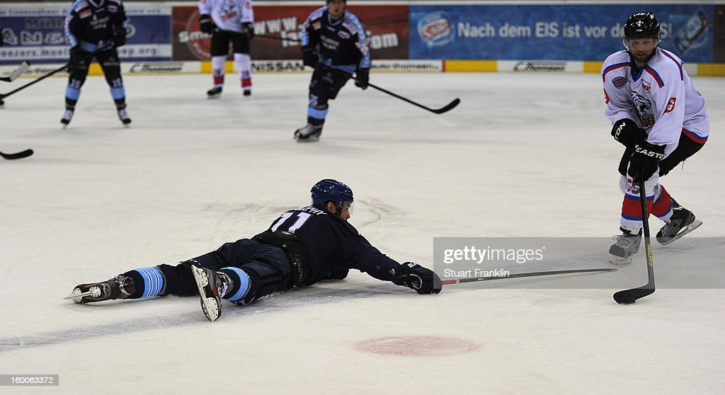 Colin Murphy of Hamburg is challenged by Casey Borer of the Ice Tiger during the DEL game between Hamburg Freezers and Thomas Sabo Ice Tigers at O2 World on January 25, 2013 in Hamburg, Germany.