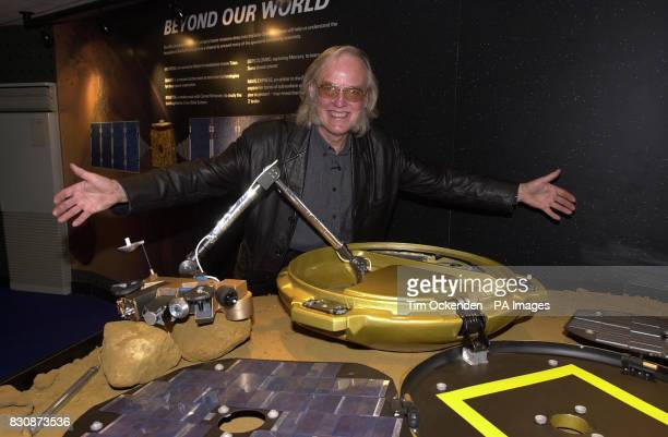 Colin Pillinger Open University professor of astronomy at the Farnborough Air Show Hampshire with the Beagle 2 landing craft that will be launched...