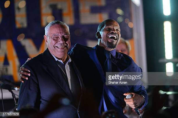 Colin Powell and Jamie Foxx perform at the 4th Annual Apollo In The Hamptons Benefit on August 24 2013 in East Hampton New York