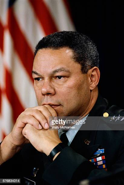 Colin Powell Clasping Hands under Chin