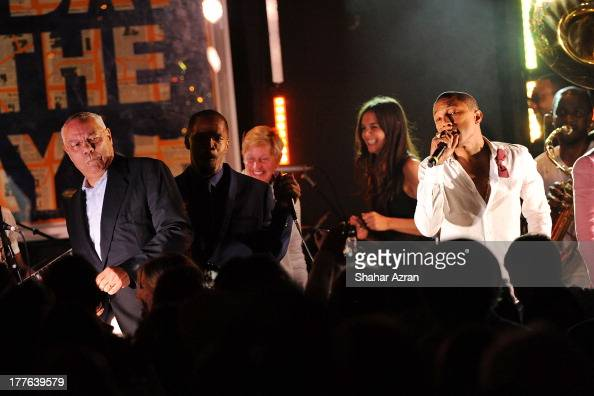 Colin Powell Jamie Foxx Ellen DeGeneres katie Holmes and Pharrell Williams perform at the 4th Annual Apollo In The Hamptons Benefit on August 24 2013...