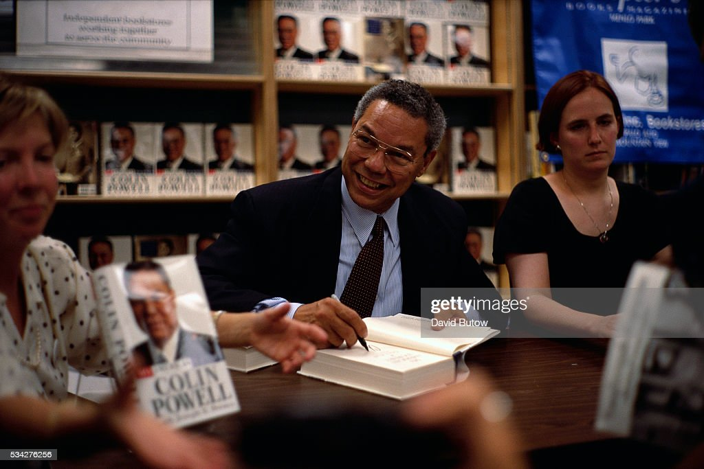 Colin Powell signs a copy of his book My American Journey An Autobiography in San Francisco during his book signing tour