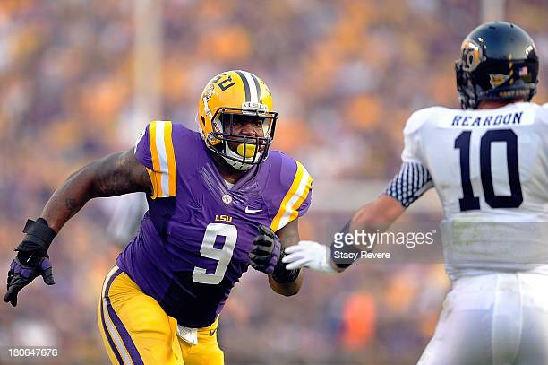 Colin Reardon of the Kent State Golden Flashes is pressured by Ego Ferguson of the LSU Tigers during a game at Tiger Stadium on September 14 2013 in...