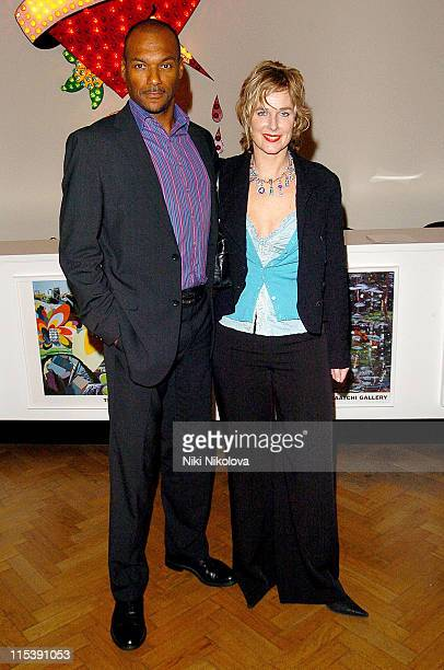 Colin Salmon and guest during Audi Makes Broadcasting History Celebrity Photocall at Saatchi Gallery in London Great Britain