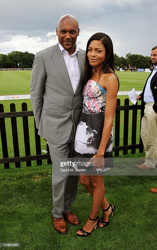 Colin Salmon (L) and Noamie Harris attend the Audi International Polo at Guards Polo Club on July 28, 2013 in Egham, England.