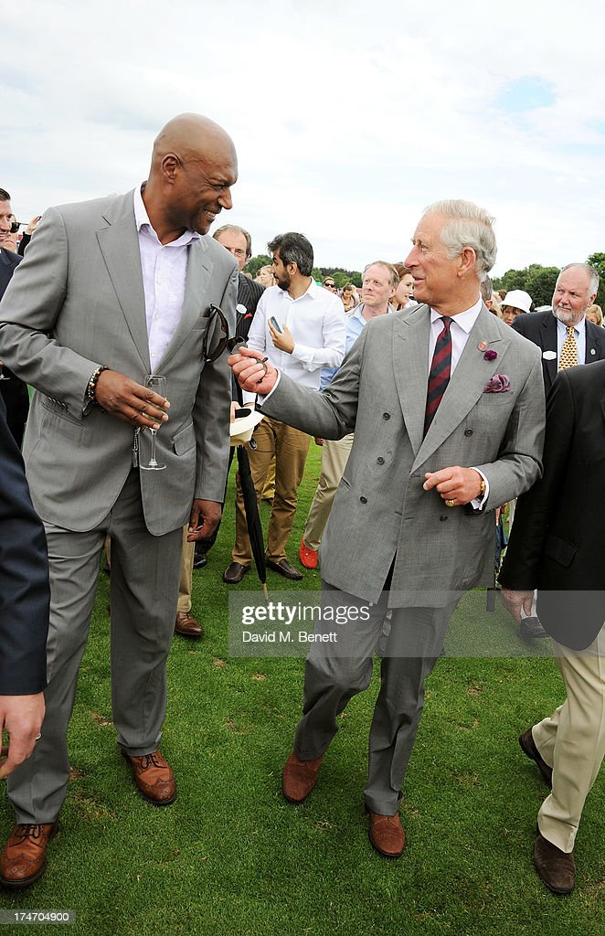 Colin Salmon (L) speaks with HRH Prince Chalres, Prince of Wales, attend the Audi International Polo at Guards Polo Club on July 28, 2013 in Egham, England.