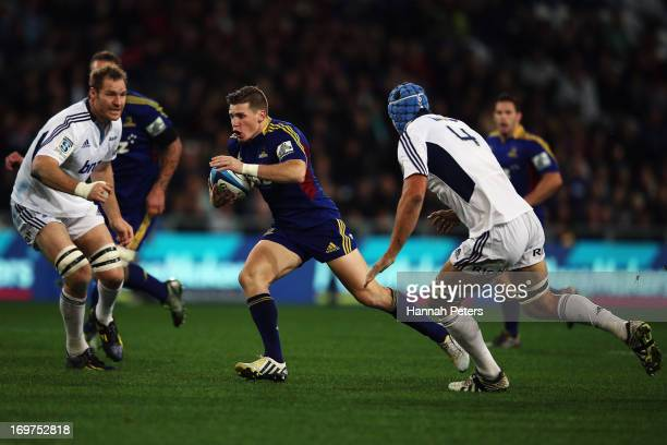 Colin Slade of the Highlanders makes a break during the round 16 Super Rugby match between the Highlanders and the Blues at Forsyth Barr Stadium on...