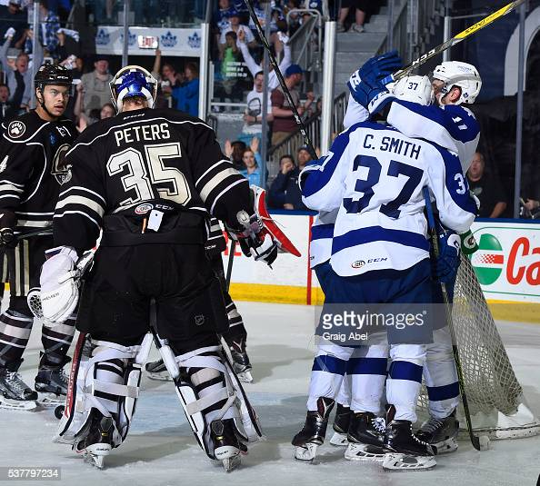 Colin Smith and Zach Hyman of the Toronto Marlies celebrate a goal in front of Justin Peters of the Hershey Bears during AHL Eastern Conference Final...