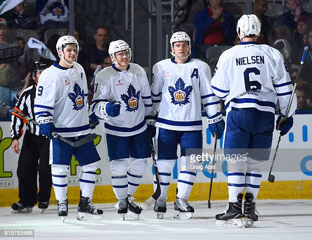 Colin Smith Andreas Johansson Byron Froese and Andrew Nielsen of the Toronto Marlies celebrate a goal against the Utica Comets during a game at Ricoh...